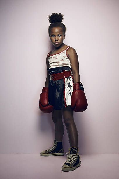 Portrait of cool young female boxer