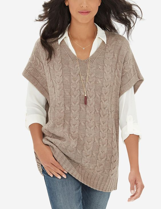I have this sweater and love it! I usually wear a long sleeve T-shirt under it though. I should try a blouse!: