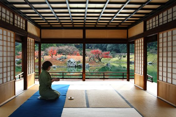 A woman prepares tea at a traditional Japanese tea house