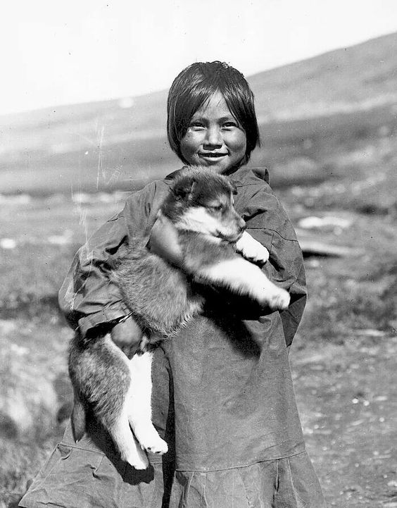 Inuit girl with puppy. 1922. Alaska. Photo by Alfred M. Bailey. Source - University of Wyoming, American Heritage Center.