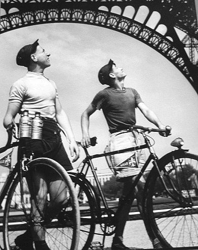 Robert Doisneau // Two cyclists from French city Lille looking at the Eiffel tower, 1950 in Paris