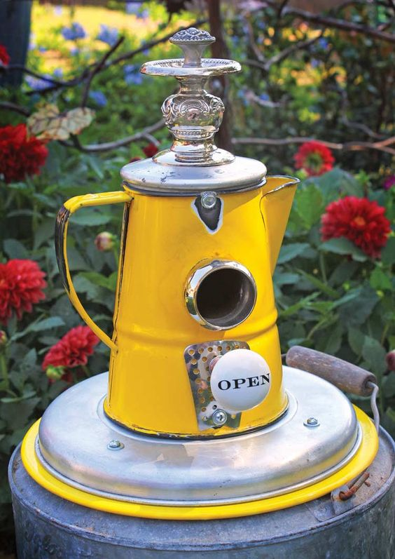 Birdhouse made from a yellow porcelain enamel pitcher. Love the Open doorknob!