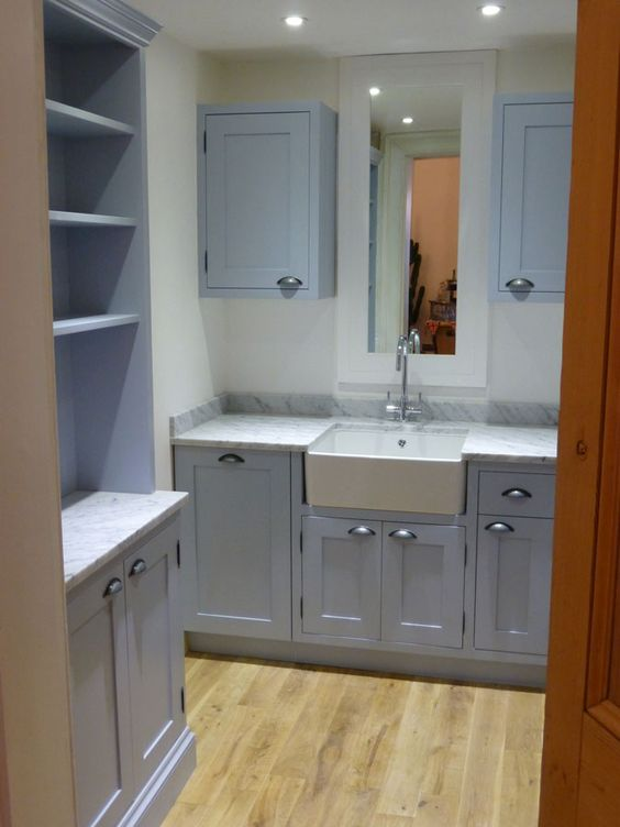 Parma gray for the utility cupboards and a belfast sink for Bespoke kitchen cabinets