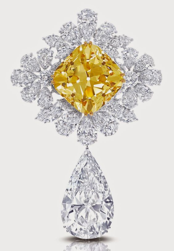 "The Royal Star of Paris, a brooch (which also can be worn as a pendant) has two diamonds of at least 100 carats each: the ""Graff Sunflower,"" a 107.46-carat fancy yellow cushion cut diamond and the ""Graff Perfection,"" a 100-carat D flawless pear shape diamond drop."