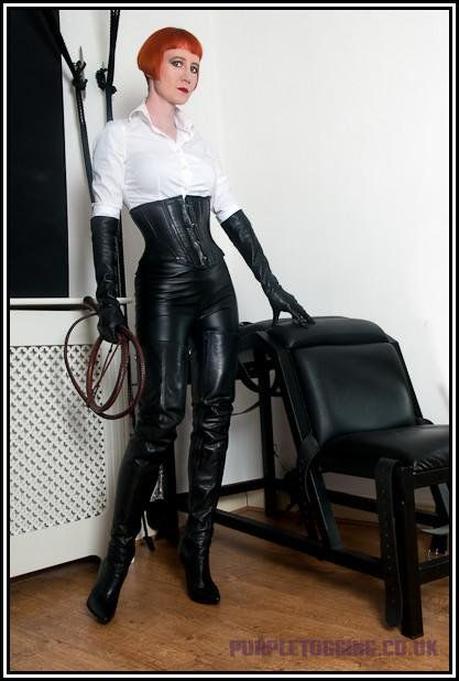 image Two strict riding mistresses burn and whip their slave