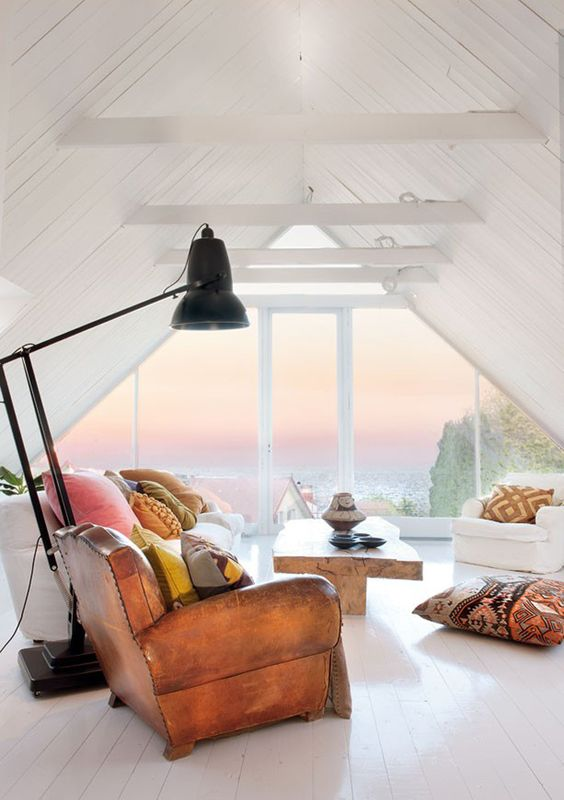 colorful   pillows , wood coffee table white floor white walls