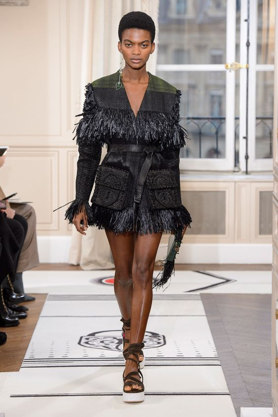 The Spring 2018 Schiaparelli Haute Couture show whisked guests away to far off lands and into the arms of Mother Nature. The collection transcended notions of old, new, near, or far. Tribal under…