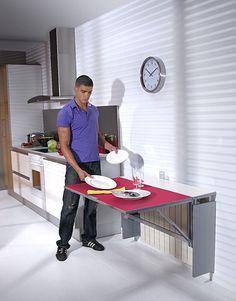 Mesa de cocina plegable cubrerradiador Mesa mural disenada alojar en su interior un radiador y optimizar el espacio ocupado por este. Constituye un atractivo cubreradiador convertible en mesa cuando sea necesario.Encimera principal de vidrio coloreado de 4 mm. Encimera