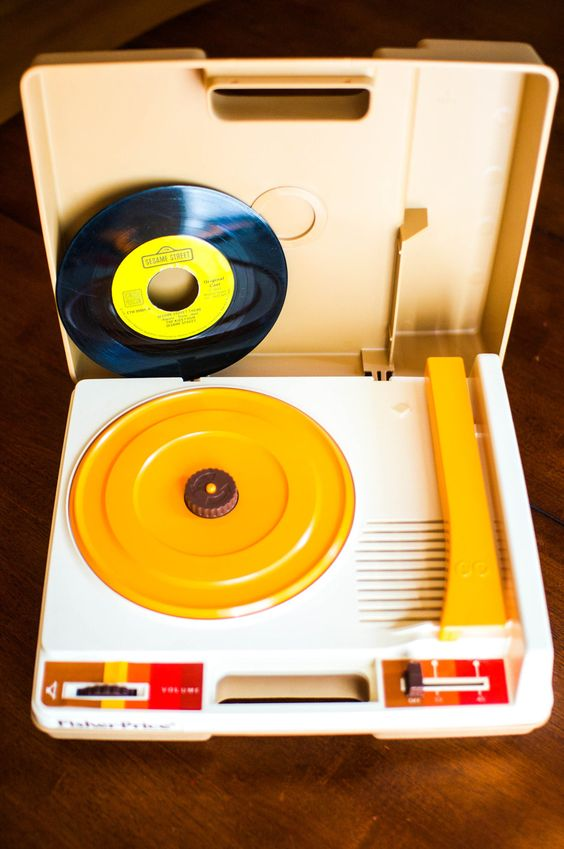 Vintage Fisher Price Portable Toy Record Player...still have mine and it still works...I would sit in my room for hours and listen to my records