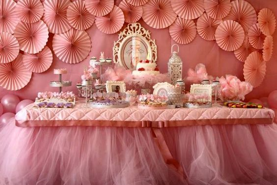 LOVE the things on the wall with the tulle hanging from the table.: