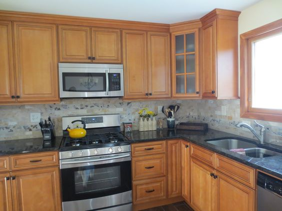 Kitchen Remodel With Maple Cabinets Golden Eye Granite And Travertine Tile Backsplash