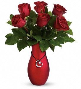 Love and romance are still in fashion. Here is our Passion's Heart Bouquet by Teleflora.: