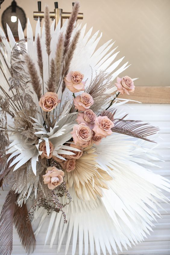 Dried flower arrangement with roses at a wedding