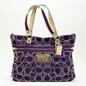 Wow Purple and Gold Coach purse!  So want this!