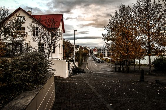 """Tjarnargata street - Tjarnargata street in downtown Reykjavik in autumn colors.  Tjarnargata street is situated along the west side of the pond (tjörnin) in downtown Reykjavik. Tjarnagata is one of the oldest street in Reykjavik and the current name dates back to the mid-nineteenth century. There are number of historic buildings in Tjarnargata, mostly wooden houses originated from Norway.  If you like my work you can follow me on Facebook <a href=""""http://www.facebook.com/dagurj"""">here</a…"""