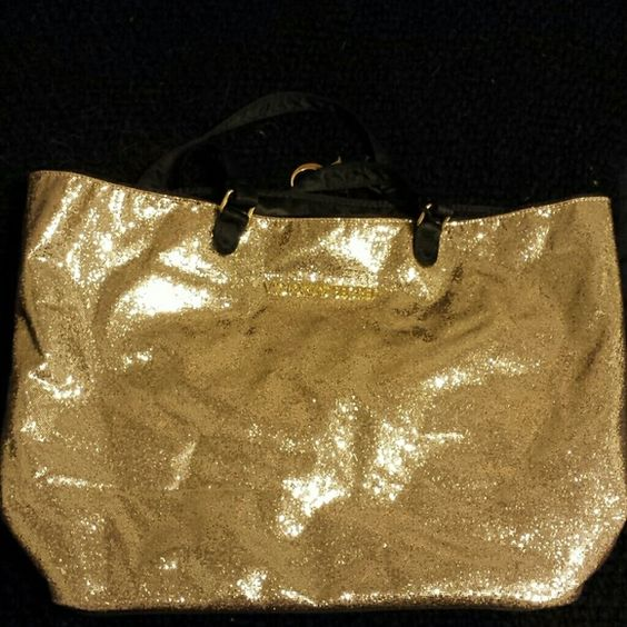 Victoria's Secret Fashion Bag Large Gold sequin/glitter bag from Victorias Secret. Never used. Have had it stored all along. Will accept offers. Victoria's Secret Bags Travel Bags