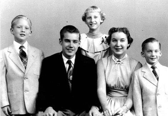 A young Donald Trump, left, is pictured with his mother and mother and siblings Maryanne a...