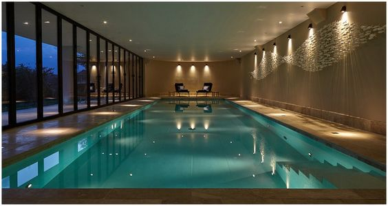 indoor pool with scabetti fish sculpture design by dynargh design