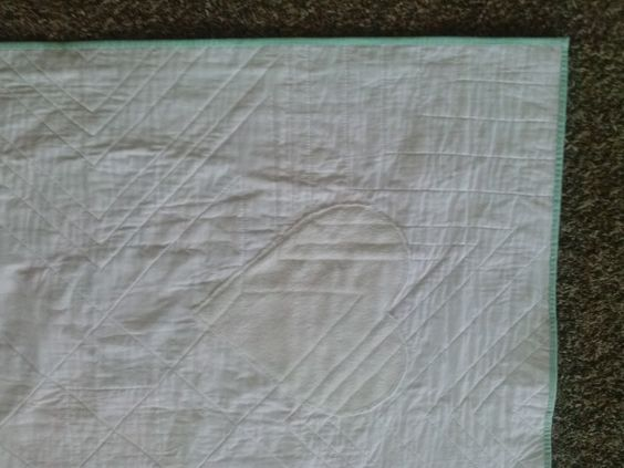 hidden minky heart on the back of this baby quilt