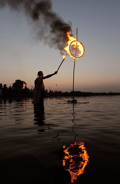 Turov, Belarus: A man takes part in the Ivan Kupala festival which celebrates the summer solsticePhotograph: Vasily Fedosenko/Reuters