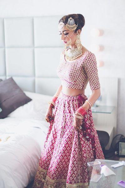 nosering, jhoomer, elbow length sleeves, pink bridal lehenga , fushcia lehenga, magenta lehenga, raspberry pink lehenga, getting ready, sikh bride, all over lehenga, lehenga with small booties