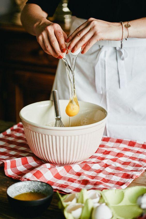 cracking an egg for a home made cherry clafoutis à la @mimi