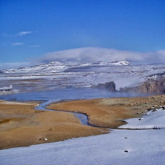 """Image by @vikster101 in Iceland. """"Geothermal water melting snow and ice""""."""
