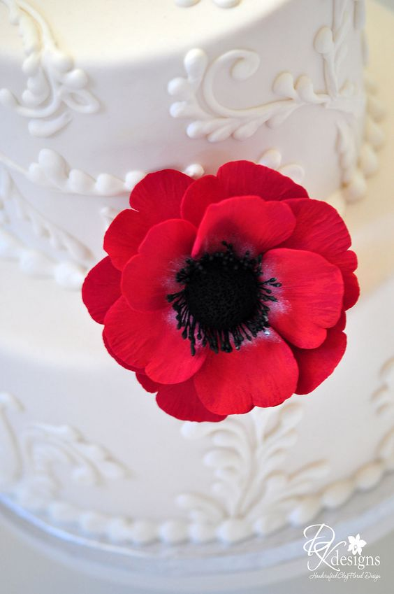 Anemone in stunning contrast to a white cake