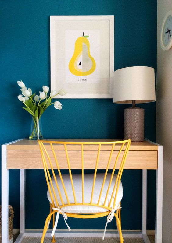 Use teal and mustard yellow to create a sophisticated workspace