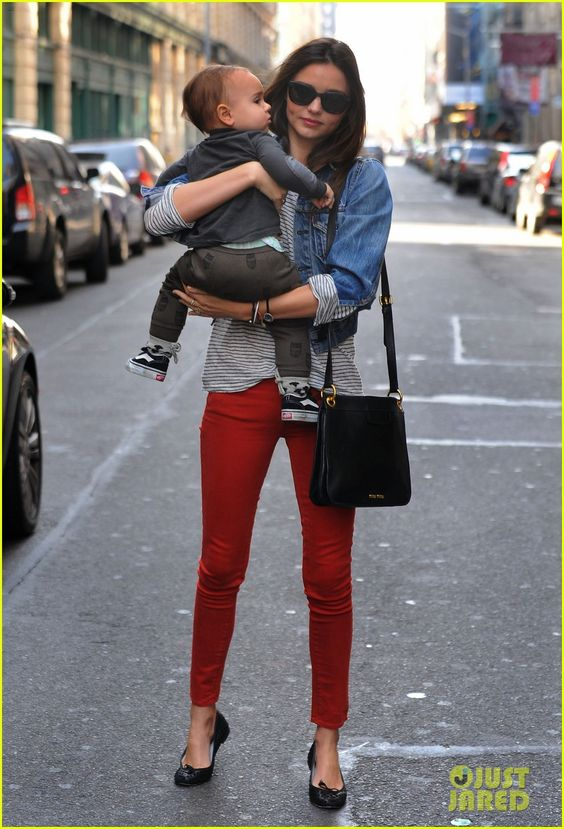 Miranda Kerr. it's like she's a model or something... Striped top. red skinnies. denim jacket. black flats