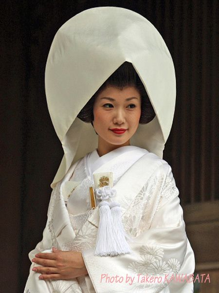 This is the traditional style of bride in Japan.  Until around 1960, every bride took this style. And wedding ceremony was always performed in the shrine.  But by the influence of USA and Europe, they liked to take western wedding dress. So now only one third or less takes this style. I took this photo Meiji Shrine (the biggest shrine in Japan).: