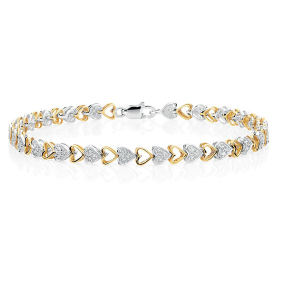 Wear your heart on your sleeve with this beautiful bracelet featuring a 1/4 carat of diamonds set in heart links of stunning 10kt yellow and white gold.