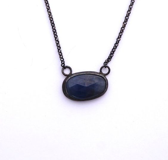 Bezel Set Sapphire Necklace Solitary Sapphire by foxandkin on Etsy  Dark blue sapphire in black sterling silver. Earthy and simple. Quatrefoil back adds great detail
