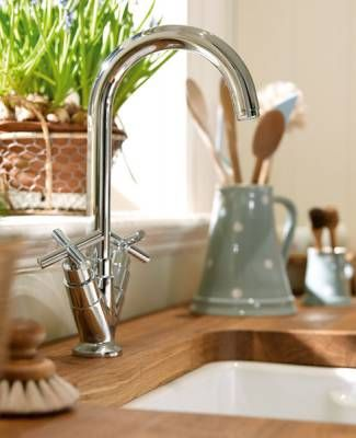 Howdens kitchens.. love the wooden work surface and belfast sink: