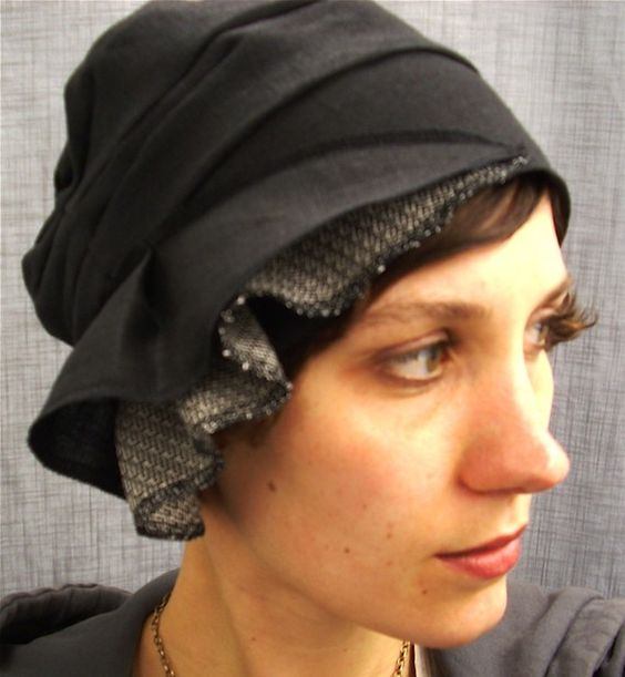 I LOVE this hat. Can you not see me wearing this hat?!  Totally me. cloche  black linen by lizarietz on Etsy, $40.00
