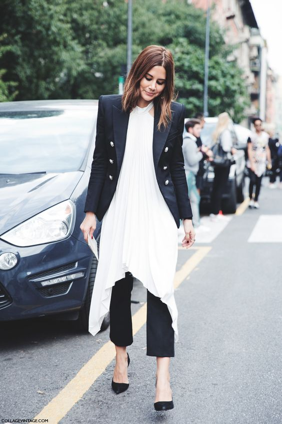 Shop this look on Lookastic:  http://lookastic.com/women/looks/white-tunic-and-black-double-breasted-blazer-and-black-dress-pants-and-black-pumps/3969  — White Silk Tunic  — Black Double Breasted Blazer  — Black Dress Pants  — Black Leather Pumps: