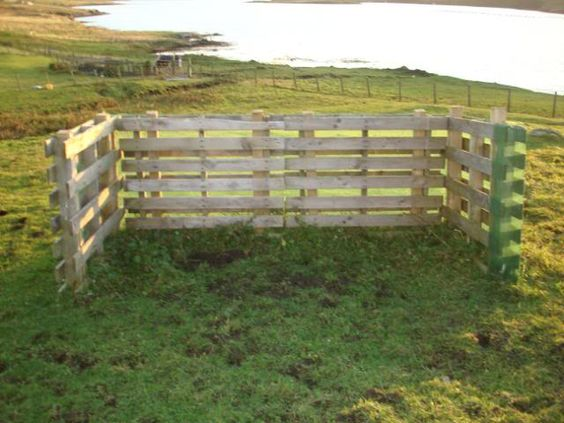 Very cool idea, pallet slipped over posts... Use pallets to create coop?  Painted red to match barn?  Dark Brown?