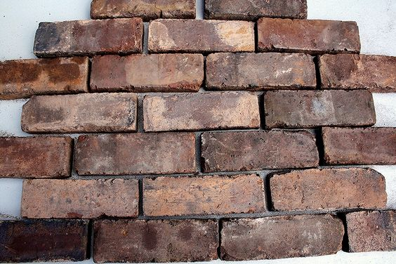 Brick Slips are produced by cutting the face off a full sized brick. They are used to give the effect of a full brick wall without the hassle of building one.  At Cawarden we provide a brick slip cutting service all on site. The brick can be selected from our wide range of reclaimed bricks and cut to produce the brick slip to your requirements.  Walsall Wood Brindles are just one example of the bricks we have in stock which can be cut into slips.   These bricks are 9
