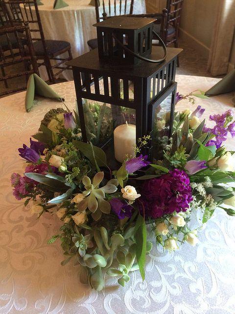 Purple and green wedding centerpiece lantern arrangement