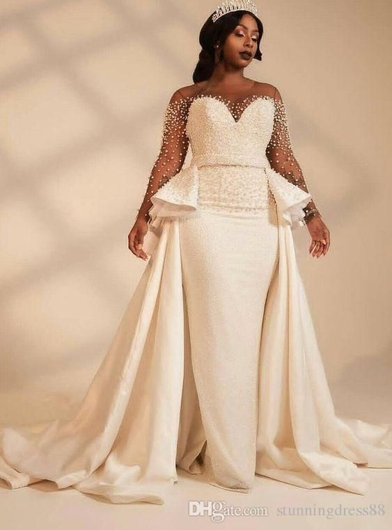 Discount Amazing Pearls Designer African Wedding Dresses Bridal Gowns Long Illusion Sleeves Beaded Satin A Line Court Train Wedding Gowns Cheap Designer Lace We Cape Wedding Dress Discount Wedding Dresses African