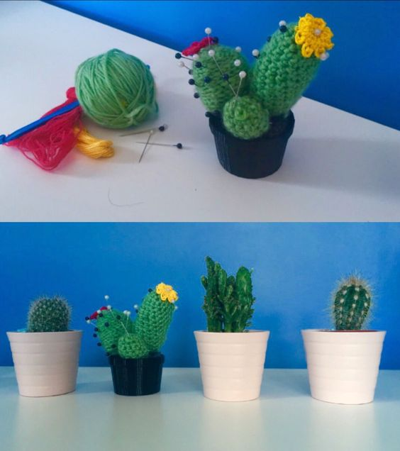 Crochet cactus with flowers and pins as spikes  ( 3D- printed black vase )
