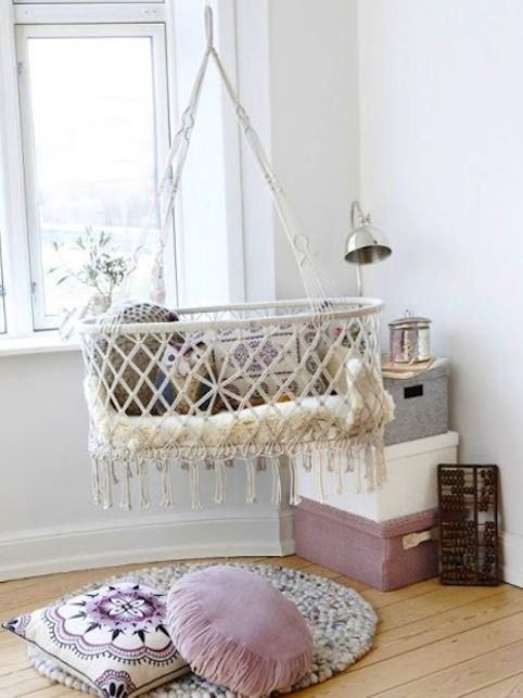 "Hanging ""crib."" Supposed to help baby transition from womb to world, when they wiggle, it gives a slight rocking motion to the ""crib"" which sends them right back to sleep!:"
