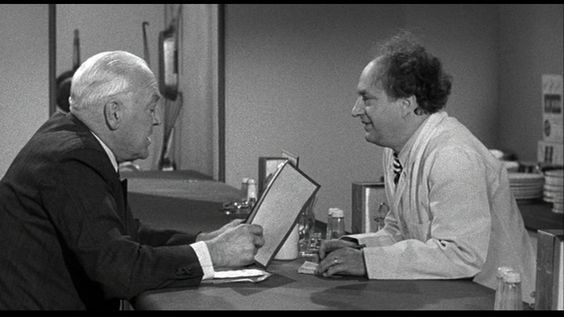 Larry Fine recommends two fried eggs to the customer who wants creamed chipped beef on toast instead. | Of Cash and Hash (1955), a Three Stooges short produced and directed by Jules White; distributed by Columbia Pictures