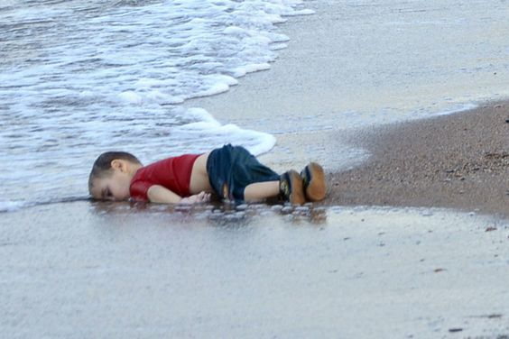 Washed up body of a refugee child who drowned during a failed attempt to sail to the Greek island of Kos, at the shore in the coastal town of Bodrum, Mugla city, Turkey, on Sept. 2, 2015. (Photo by Dogan News Agency/EPA)