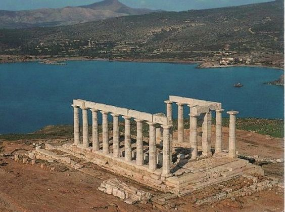 The Temple of Poseidon - At Cape Sounion stands a lovely temple dedicated to Poseidon, the god of the sea in classical mythology. The remains of the columns framing the sky and looking like a portal into eternity are perched on the headland, surrounded on three sides by the sea