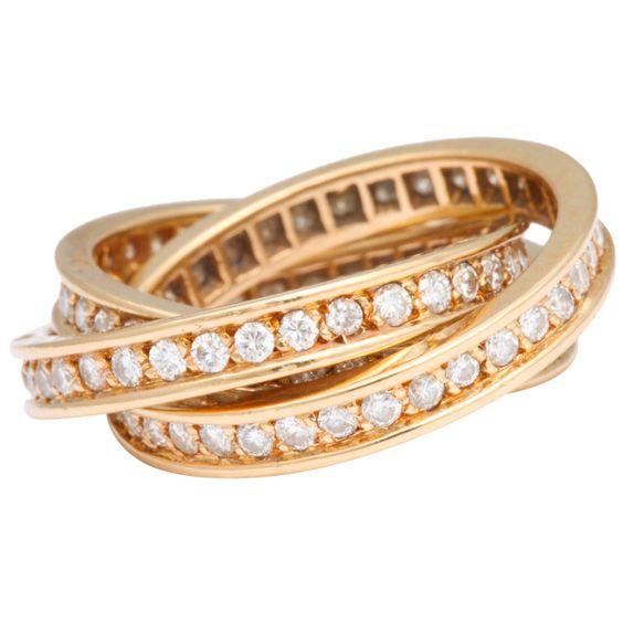 Cartier Diamond Gold Trinity Ring | From a unique collection of vintage band rings at http://www.1stdibs.com/jewelry/rings/band-rings/