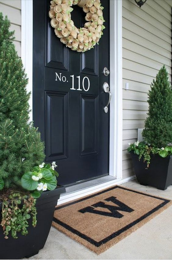Love the black door with white house number and door mat with initial.: