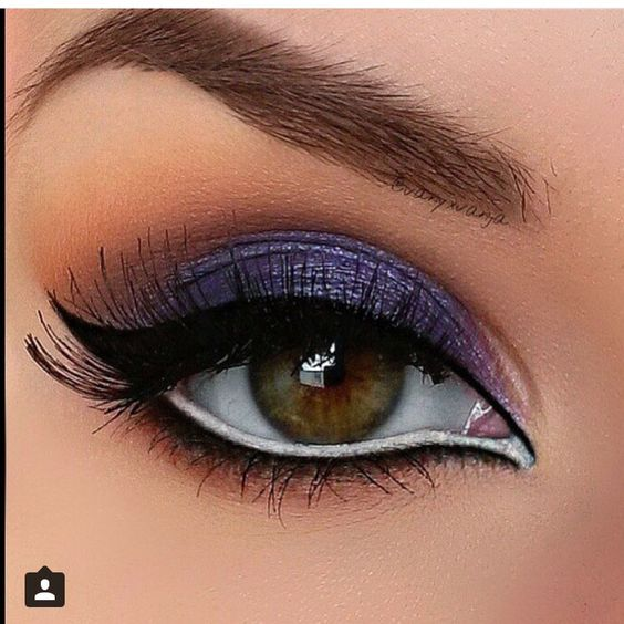 Dramatic bold purple eye make up