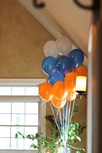 Stacking ballons tied to a beanbag baseball.