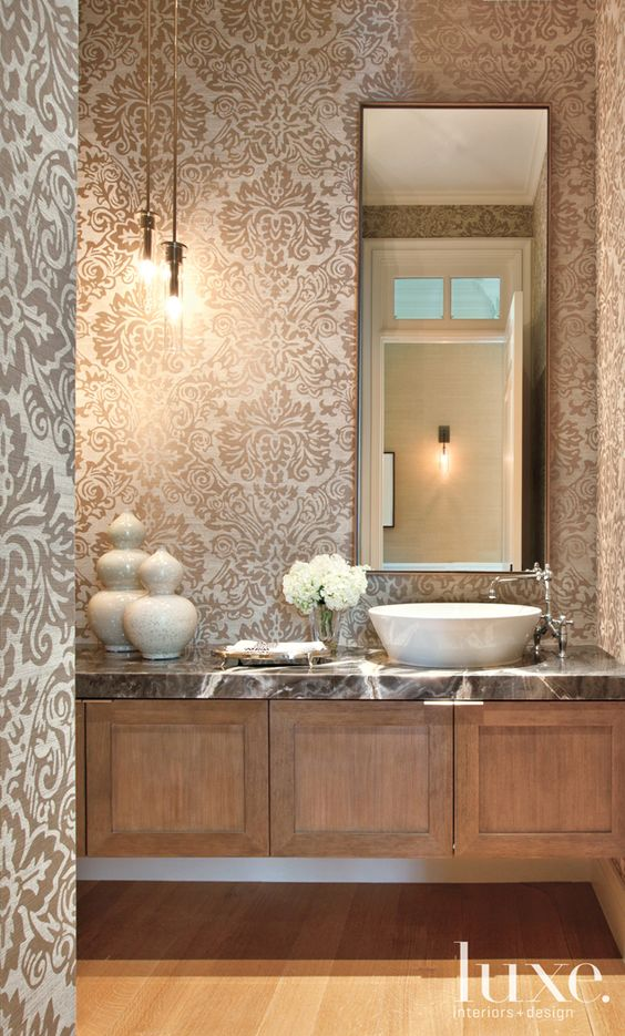 The powder room in this Brentwood home features an onyx